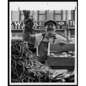 Moe the Vegetable Man,pushcart vendor,at his produce stand