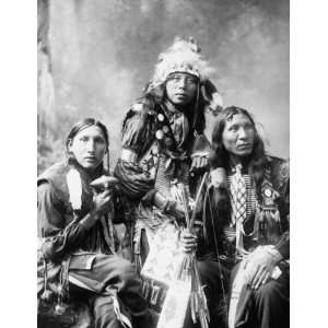 c1899 phoo hree young Indian men, probably Sioux, wearing naive