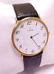 CONCORD SWISS 14KT GOLD CASE ARABEC NUMBERS WHITE DIAL & LEATHER BAND