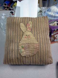 Handmade Primitive looking pillow for Easter with old quilt bunny