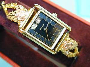 Stamper Black Hills 10k Gold band Ladies wrist watch very pretty good