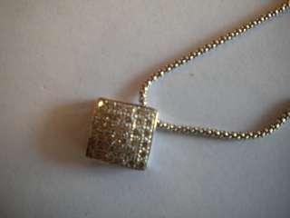 .75 CARAT PAVE SET DIAMOND PENDANT IN 14 KARAT WHITE GOLD.