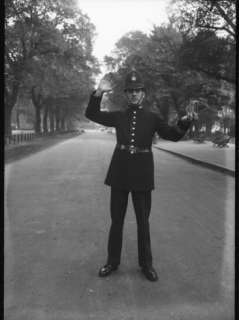 Traffic Police Officer Giving Stop Hand Signal. Metropolitan Police