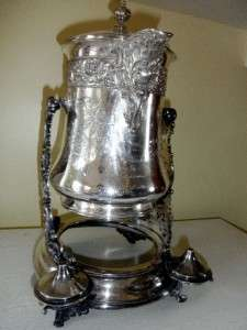 ANTIQUE SILVER PLATE TILTING ICE WATER PITCHER PRESENTED TO FLORA