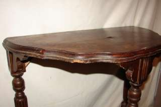 antique half moon table in tables