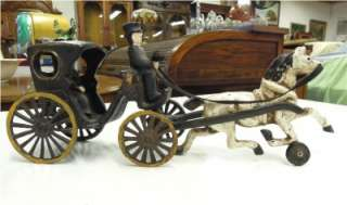 DECORATIVE ANTIQUE CAST IRON HORSE DRAWN CARRIAGE WITH DRIVER AND