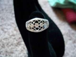 AVON, BRAND NEW, STERLING SILVER GENUINE DIAMOND RING,5