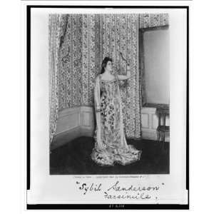 full length portrait, standing, facing right, holding up mirror and lo
