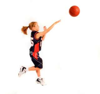 12 year old girl plays basketball Royalty Free Stock Photo